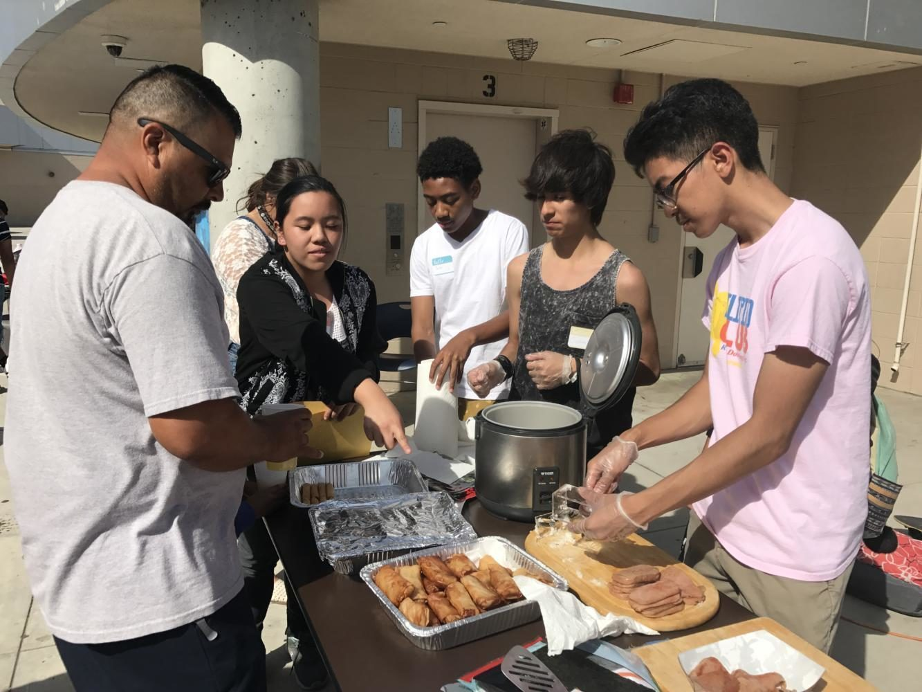 Rancho Dominguez's Filipino Club serving Eggrolls, Spam Musubi, and Turon